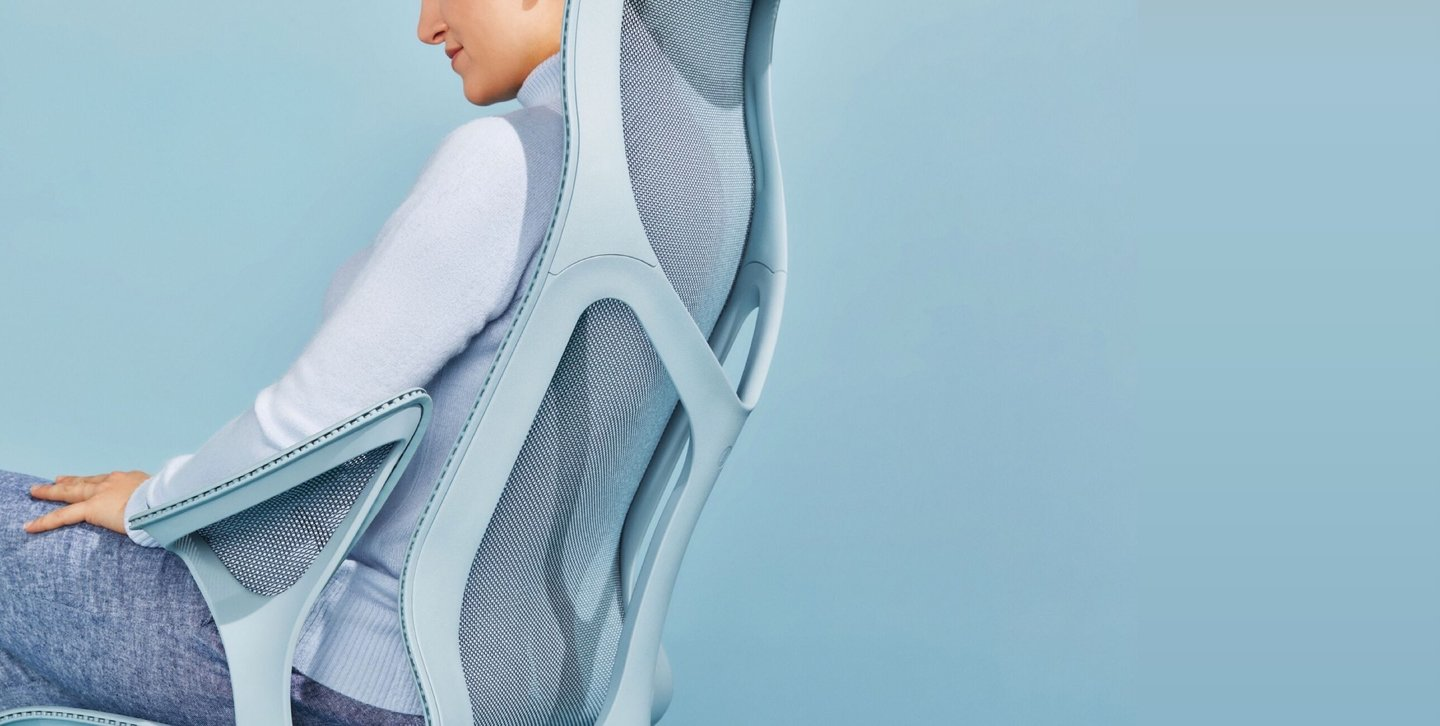 Woman leaning back in cosm chair